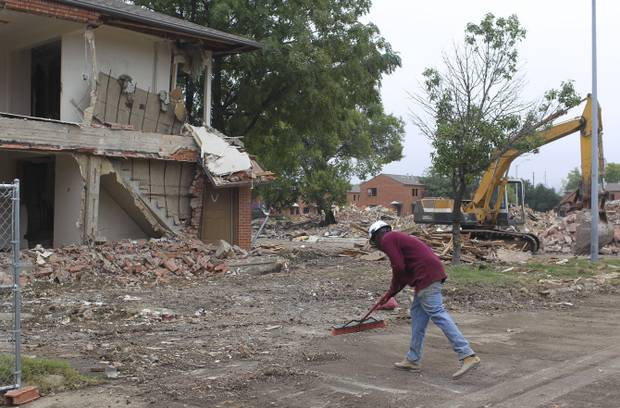 Workers demolish derelict apartments on Kings Road to make room for a new high-density Dallas Housing Authority development.