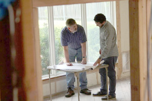 Larry Paschall and Stephan Sardone go over plans for Paschall's Casa Linda Forest home. (Photo: Larry Paschall, AIA, HPD Architecture)