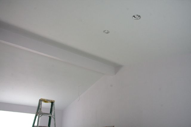 A vaulted ceiling will let much more light into the living and kitchen areas.