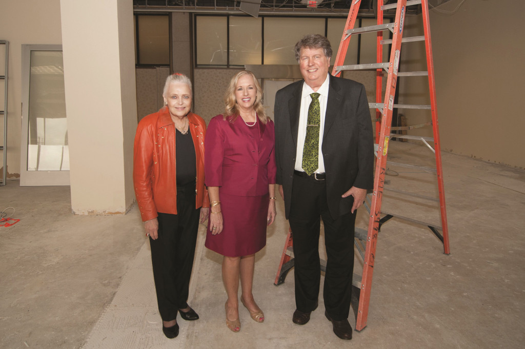 Ebby Halliday Realtors President and CEO Mary Frances Burleson, Preston Center Sales Manager Ginger Gill, and Chief Financial Officer Ron Burgert inside the Preston Center office space that will soon house as many as 100 agents.
