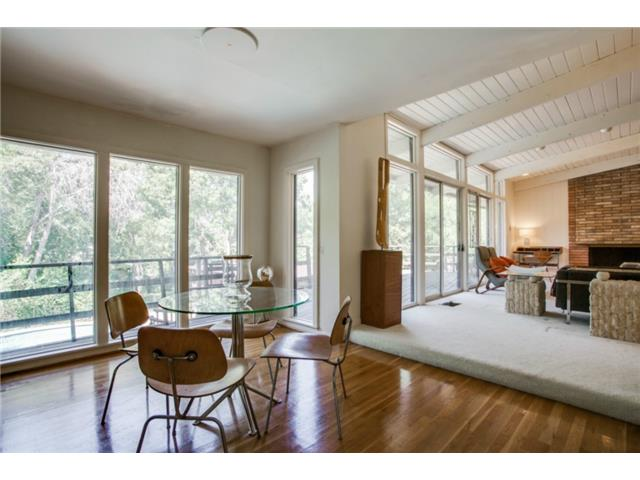 Dining Room features hardwood floors and views of the pool.
