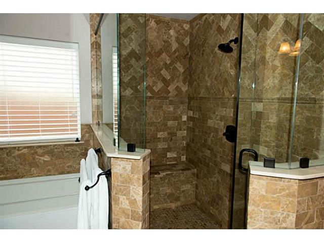 Separate bathtub and shower, with beautiful marble tile and glas