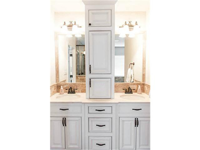 His and hers vanities with marble countertops.