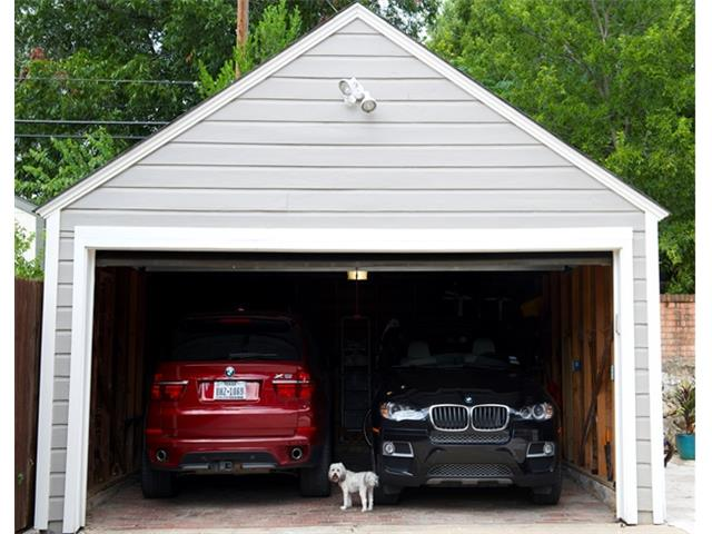 Garage is large enough to fit 2 SUVs.