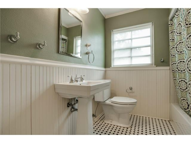 Hall Bath updated with period style bead board wainscoting and d