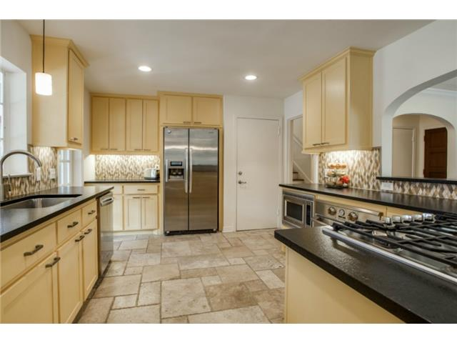 This gorgeous kitchen has custom painted cabinets, upscale stain