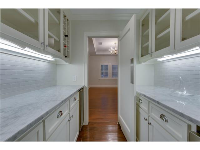 Butler's pantry between kitchen and dining room has wine cooler