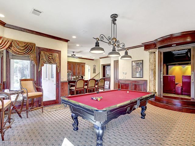 game room with  room for pool table, Huge Texas Shuffle Board, a
