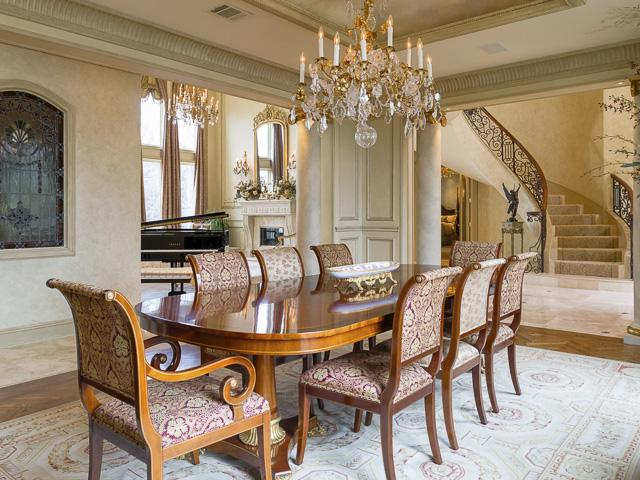 Formal dining room with exquisite imported chandelier and sconce