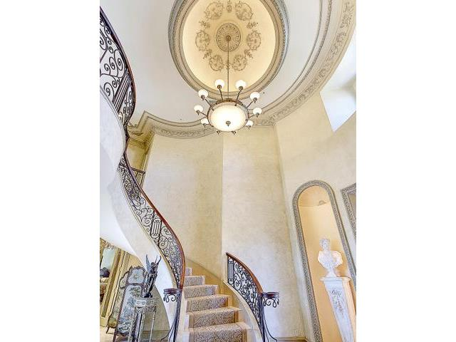 Two story foyer with domed ceiling & great attention to details