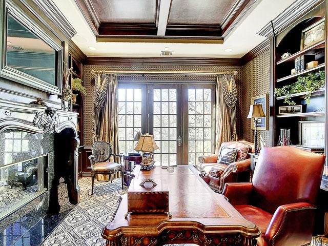 Formal study with fireplace & built-ins on main living level.  H