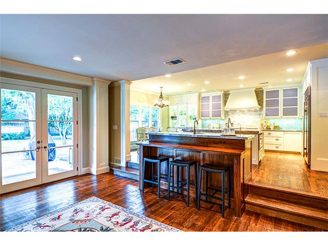 This most attractive kitchen is separated from the family room b