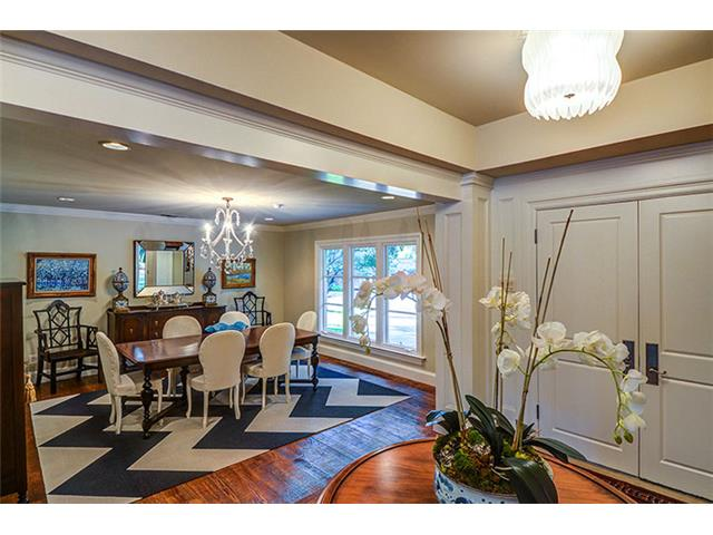 Across the foyer is the formal dining room.  Rich, wide plank ha
