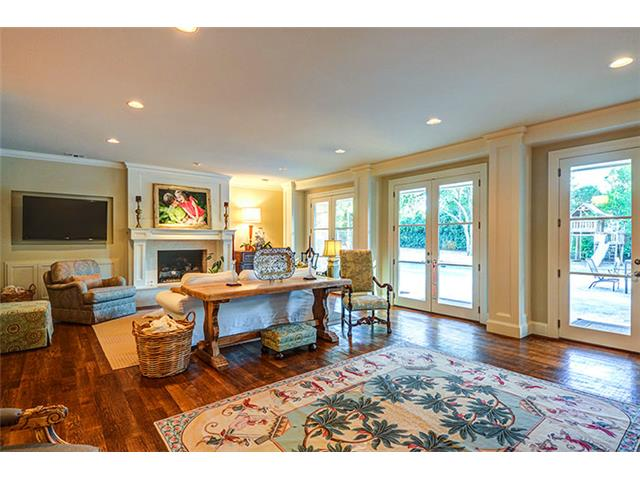 The handsome stone fireplace and hearth provides an inviting foc
