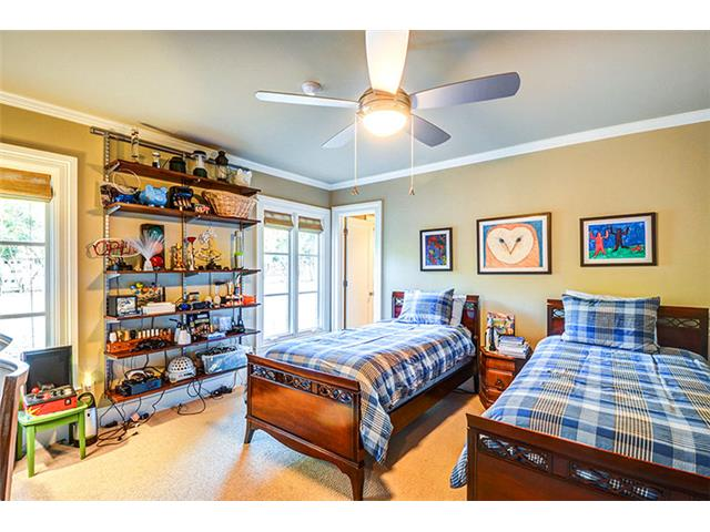 Each secondary bedroom is generously sized and features a privat