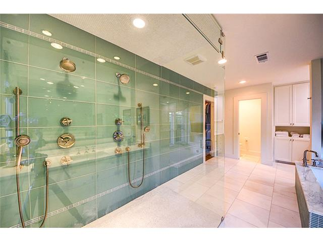 The double shower is truly spectacular. More glass tiles by Ann