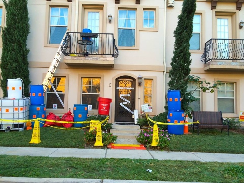 "Near Highland Park High School, a townhome has been decorated with HazMat bins and ""Caution"" tape, lampooning our recent Ebola scare."