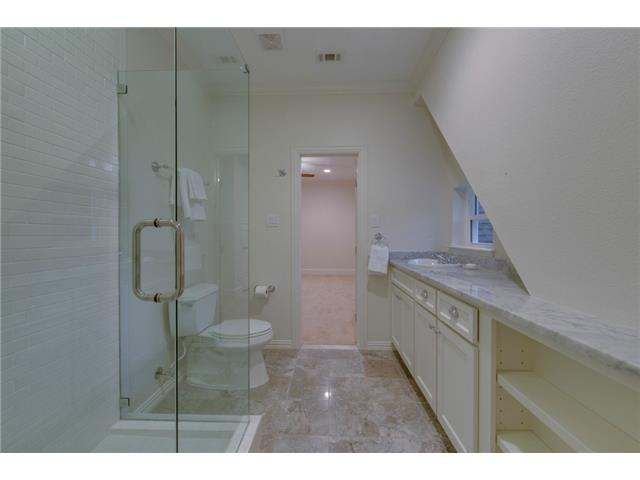 Jack and Jill bath on second floor with marble floors.