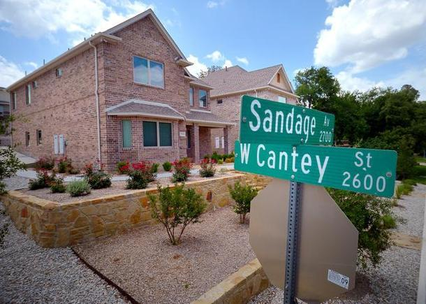 """On Sandage St. near TCU, two large, zero-lot-line homes have been built next door to one another. To curb the trend of investors tearing down homes to build """"stealth dorms,"""" residents are supporting greater restrictions for the number of co-habiting adults in these homes. (Photo: Max Faulkner/Fort Worth Star-Telegram)"""
