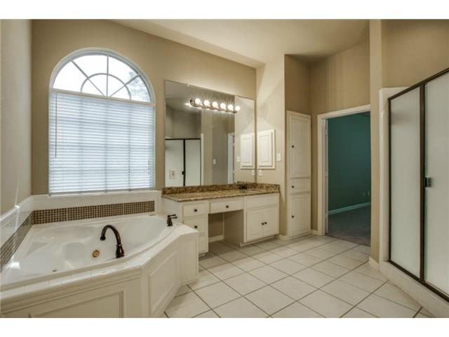 Master bath with separate dressing areas and designer glass tile