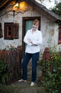 Debbie Wiggins outside her studio cottage on the grounds of her Lakewood estate, which was once a potting shed.