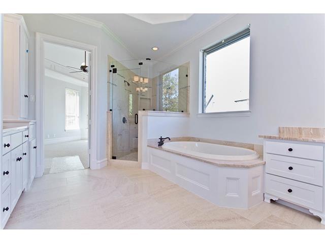 Luxurious Master Bathroom has an over-sized shower, spacious tub