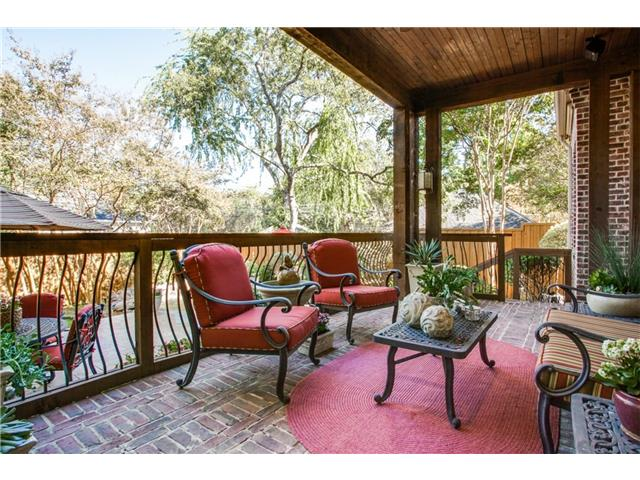 Brick Covered Patio overlooks landscaped back yard. Gas Hook-up,