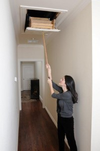 A solid oak reach hook allows the attic ladder to be pulled down and closed easily.