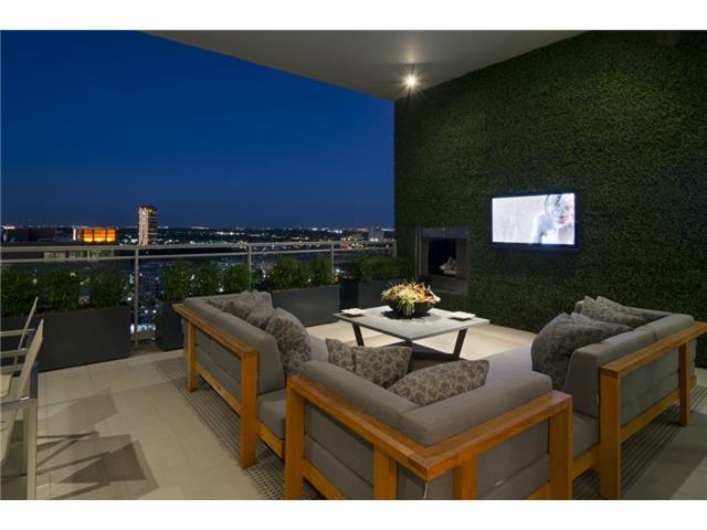 Terrace boasts faux boxwood walls, gas fireplace (remotely contr