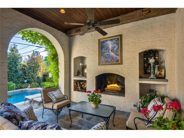 Even an outdoor fireplace & sitting area. A great outdoor room c
