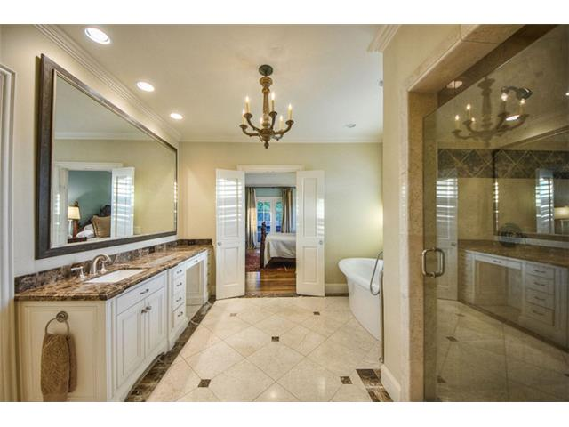 The spacious master bath is spa-inspired. Stone flooring, double