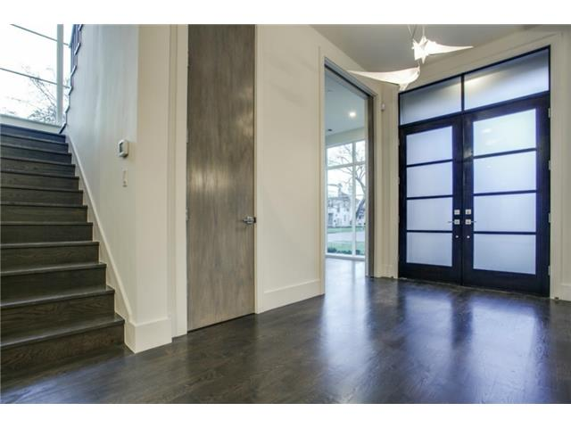 Formal Entry with 5 inch oak floors floor to ceiling windows