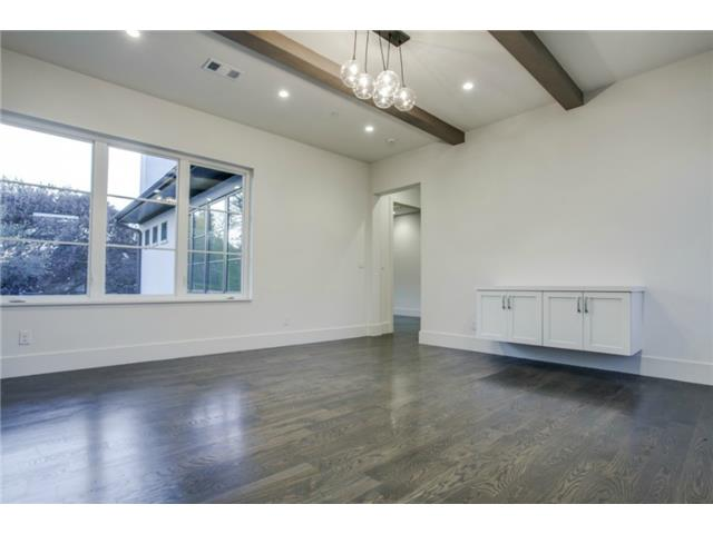 Upstairs gameroom with wood floors and beam ceiling