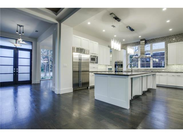 Island kitchen with Caesarstone countertop. Top of the line appl