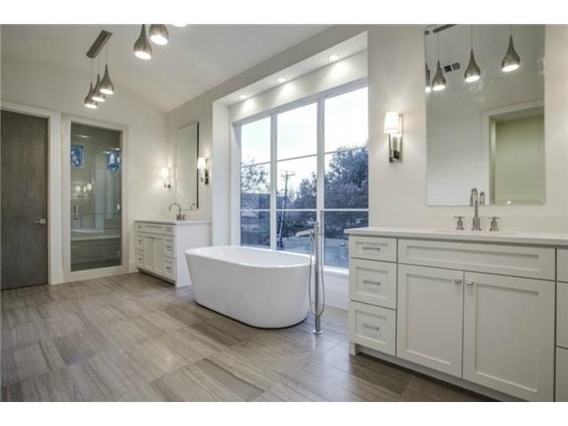 Large Master Bedroom has stone floors free standing tub double s