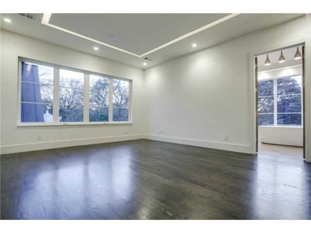 Upstairs Master Bedroom has wood floors and room illuminated wit