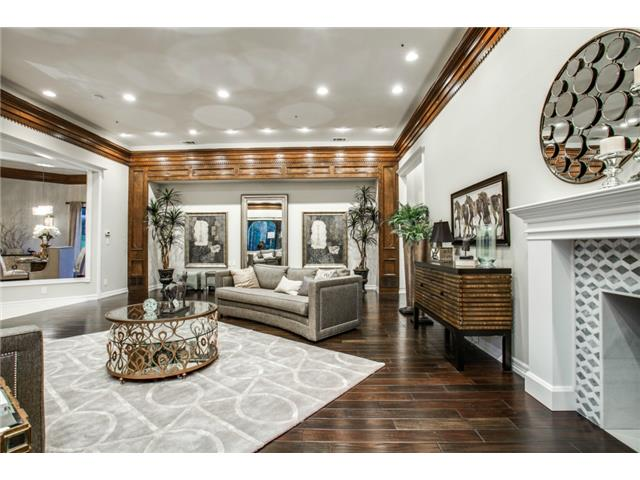 With an intricate wood crown molding encompassing this room, acc