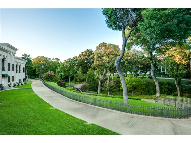 Located on 14 acres of lush trees, landscaping, and rolling hill