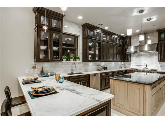 The kitchen features hand made mother of pearl mosaics accenting