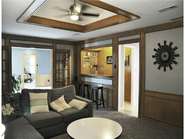 The den has a fabulous wet bar for entertaining !