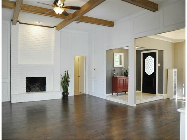A view of the fireplace and front entry !