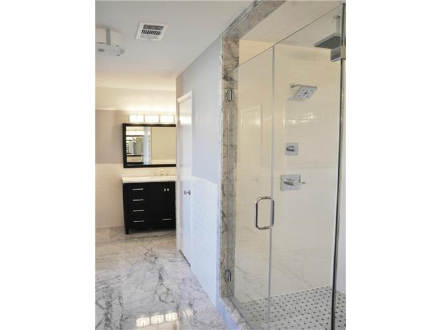 This master bath speaks for itself ! A custom shower door, dual