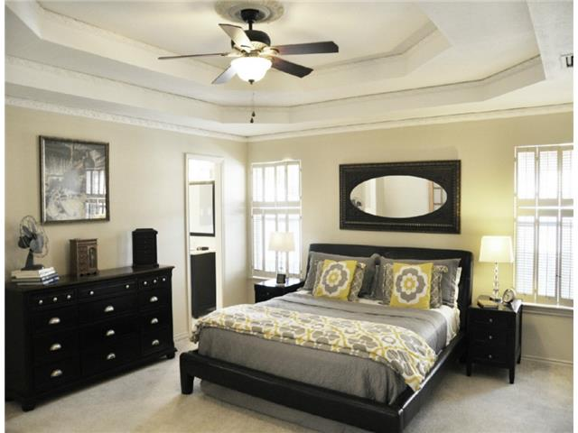 The master bedroom is generously-sized and can easily accommodat