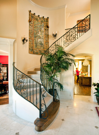 Entry stairway in two-story French style house. Photo courtesy Robert Peacock.