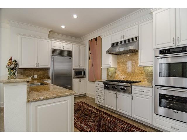 Kitchen features Sub-Zero Fridge, Double Ovens, 6-Burner Gas Coo