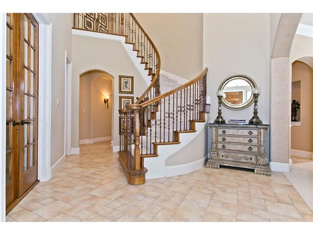 Welcoming foyer includes the sweeping staircase & Versailles pat
