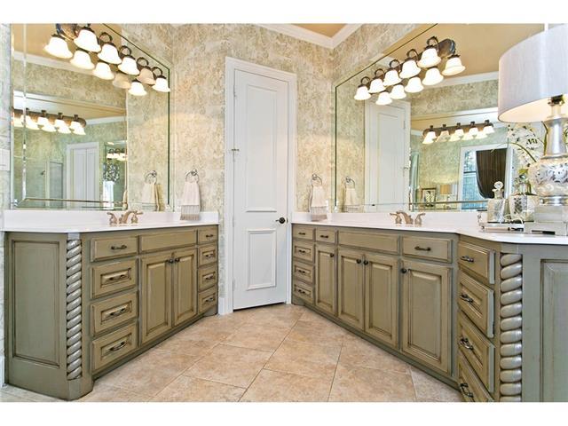 Pristine master bath includes a deep walk-in closet with handy b