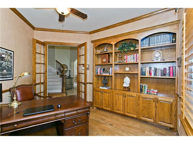 Study features built-ins & French doors to compliment the hardwo