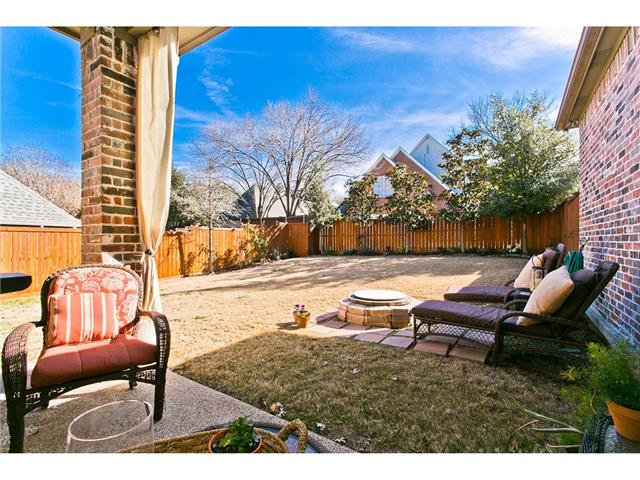 Great backyard for entertaining around the firepit or under the