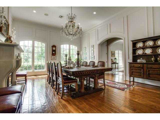 Dining room with high ceilings, beautiful picture frame moldings